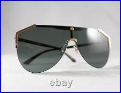 Gucci GG0584S 002 Grey Lens Gold Oversized Shield Sunglasses with Velvet case
